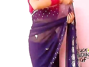 young indian wife teaching how to wear saree - 1..
