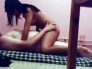 Young Indian college girl sitting on her..